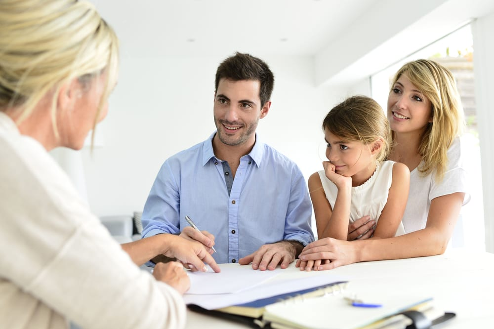 smiling family meeting mortgage lender