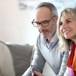 Senior couple, smiling, meeting with mortgage lender