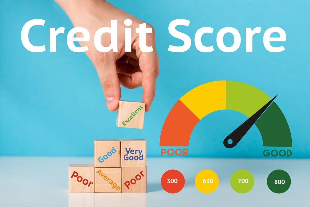 "Hand placing block that says ""excellent"" on pile. Credit score scale pointing toward ""good"""